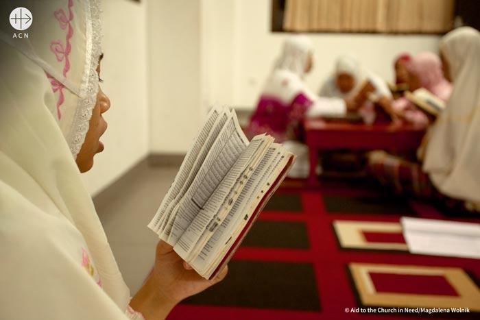 A girl reading Quran
