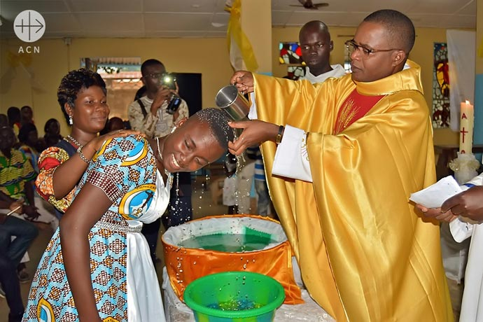 Adult baptism during holy mass.