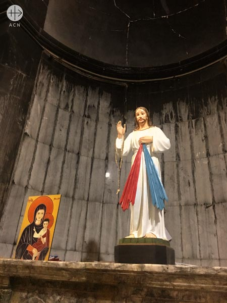 Chapel in St Mary's church in Qaraqosh. The church has been damaged by ISIS. Now prayer has returned.