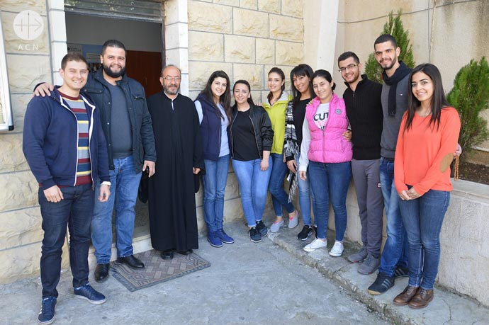 Majd Jallhoum (first from the right), secretary of the Saint Peter Relief Centre, with the gruop of volunteers of the Saint Peter Relief Centre.