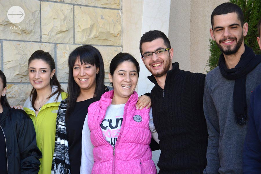 Rasha Drazy, in the centre dressed of pink, a widow who is part of the gruop of volunteers of the St. Peter's Relief Centre in Marmarita.
