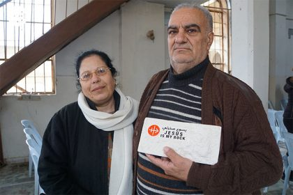 Homecomers Hasan Marmari and his wife Halloun Jreij with the Jesus is my Rock stone tablet.