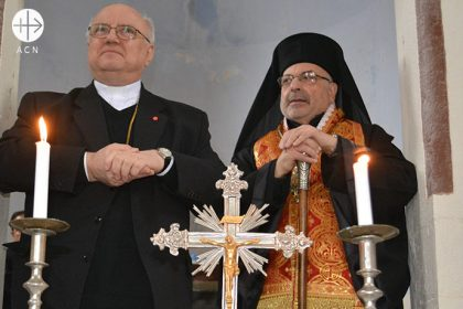 Father Andrzej Halemba (ACN Middle East Projects Coordinator) and Greek Catholic Melkite Archbishop Nicolas Sawaf of Lattakia.
