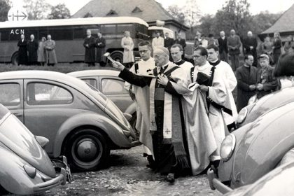 "Cardinal Frings from Cologne blesses the Volkswagen during a launching ceremony for the chapeltrucks in Königstein, 1952. He is blessing the first seventy ""vehicles for God"" (Volklswagen) provided by Flemish students an youth groups for the rucksack priests."