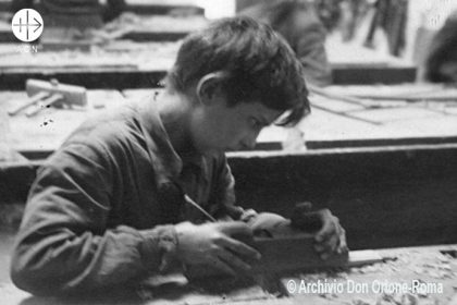Looking to his future: an orphan in one of Don Orione's vocational workshops.