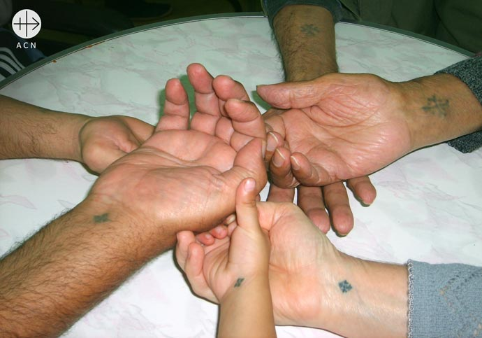 Coptic people decided to brand themselves as they felt like. This is why every Coptic, old and young alike, have a cross tattooed on their wrist, where Jesus had the nail prints.
