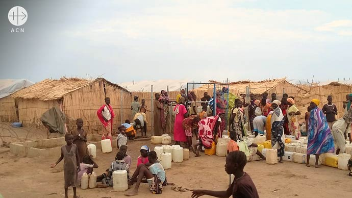Queuing for water at refugee camp for South Sudanese near Kosti in the diocese of Khartoum in Sudan