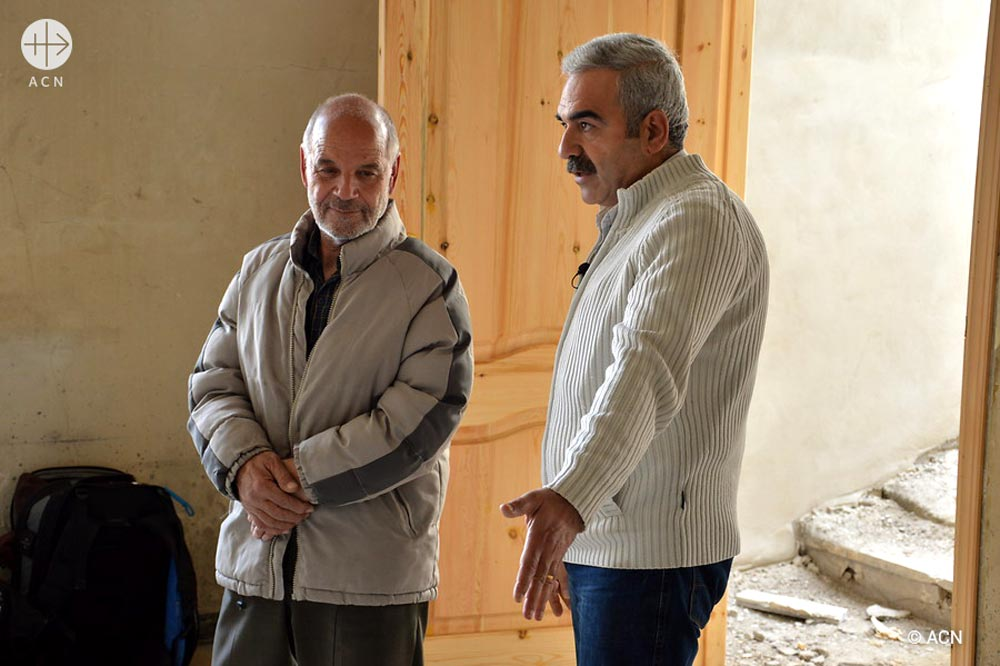 Elias and the engineer Hassib Makhoul, visiting the reconstruction works