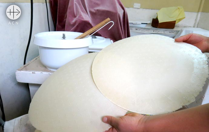 a new host baking machine for the discalced Carmelite Sisters in Abancay, Peru
