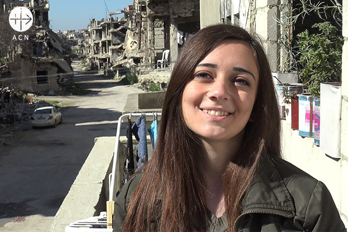 Reznan Berberaska (22) on the balcony of her family's home on the former front in Homs. It was renovated within eight months, a minor miracle when you see the destruction on the street from the balcony.