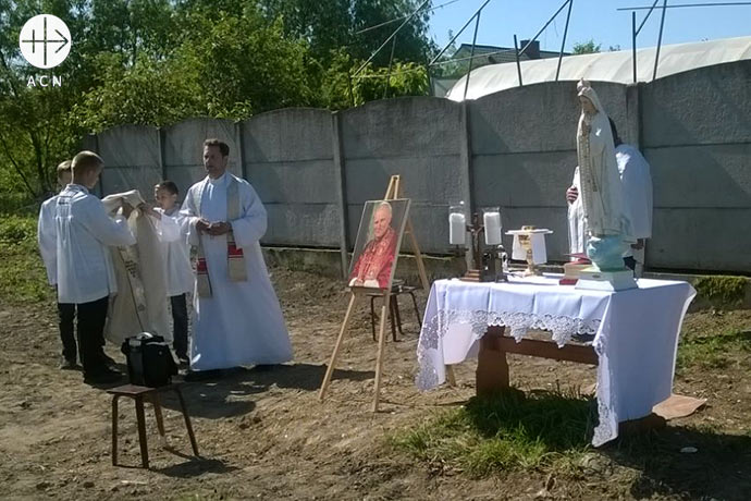 Until the church is built, Father Henryk must continue to celebrate Holy Mass in the open air.