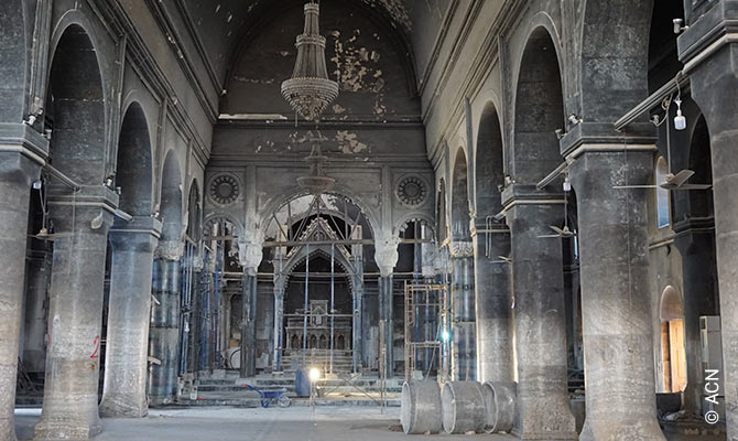 Immaculate Conception Church in Qaraqosh, biggest church in Iraq, destroyed during violence. Starting to be restored.