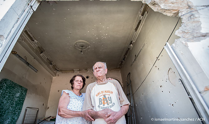 In their bombed-out home: Mary and her blind brother Sarkis live next door to the Jesuits.