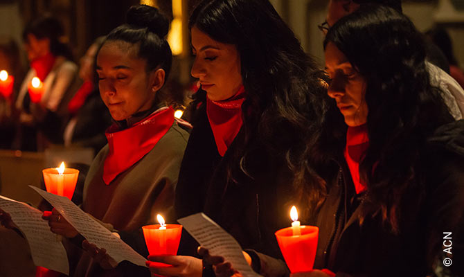 Red Wednesday in St. Michael's Cathedral in Toronto, Canada. Three young Chaldeans helped with a Aramaic hymn to honour Christian martyrs at the annual Red Mass sponsored by Aid to the Church in Need.