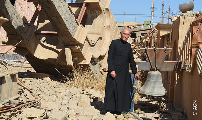 The Syrian Catholic priest G. Jahola at the remains of Mar Benham Church in Bakhdida.