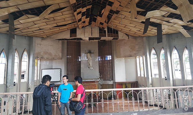 Rector P. J. Nacua in the bombed-out Cathedral of Our Lady of Mount Carmel, Jolo.
