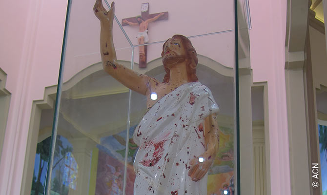 Statue stained with the blood of victims in St Sebastian's Church, Katuwapitiya.