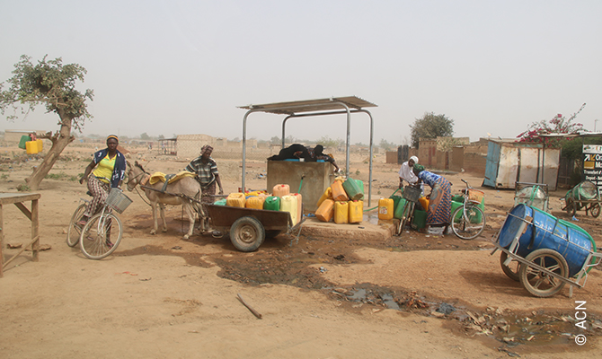 Refugees have to walk miles for water.