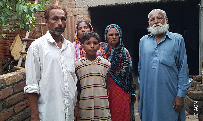 Amjad Arif, a Pakistani Catholic released after five years in prison for murder he didn't committed, with his family. He is one of 40 former prisoners and their families and friends after a Mass in Lahore's Sacred Heart Cathedral to mark their release celebrated by Archbishop Sebastian Shaw. They have been released from prison on January 29 2020.