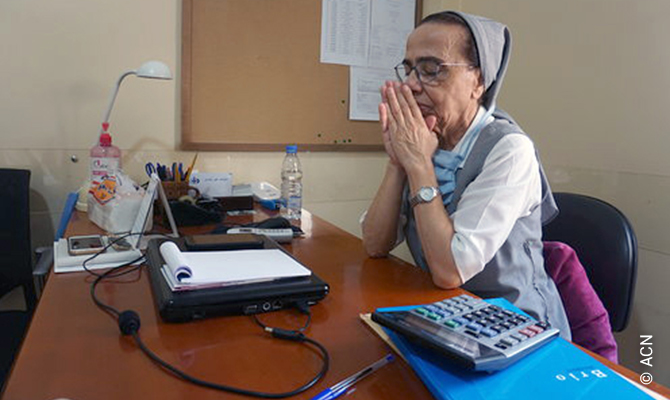 Lebanon: Sister Marie Justine el Osta, from the Maronite Sisters of the Holy Family, who serves as director of the dispensary in her office.