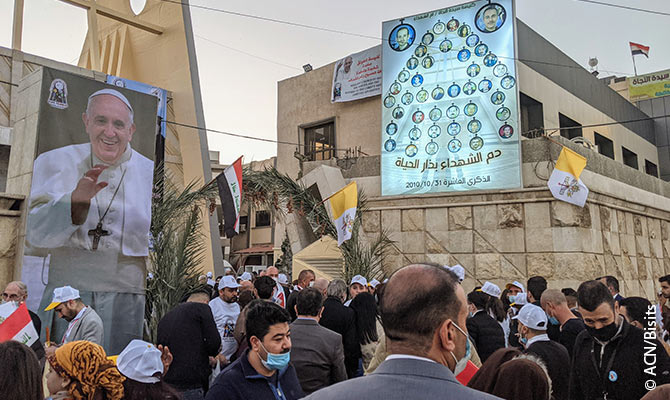 Papal visit to Iraq's largest Catholic town creates hope that Christians will return.