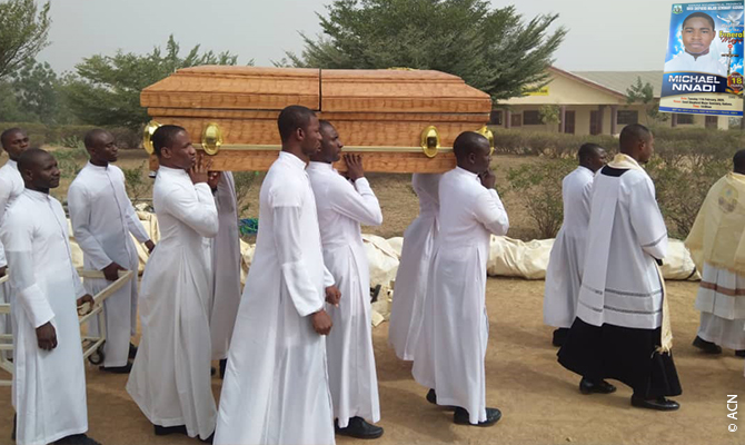 His death was a turning point: seminarians carrying their brother Michael to his grave