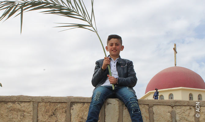 A boy at the Palm Sunday procession on 25.03.2018 in Qaraqosh, Iraq.