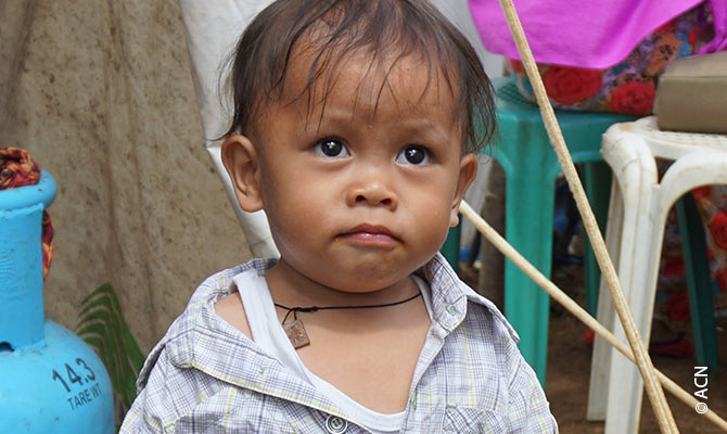 A refugee child in a Christian refugee camp after the terrible siege of Marawi.