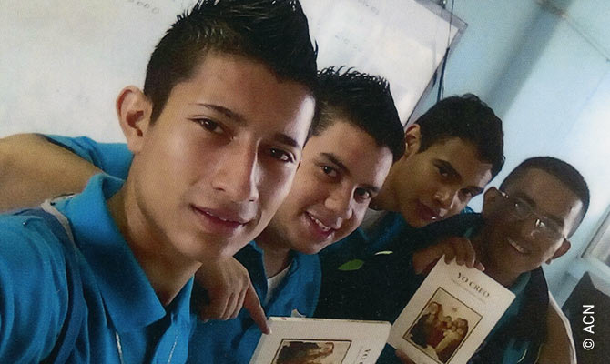 "Young people in Honduras receive the ""Small Catholic Catechism""."