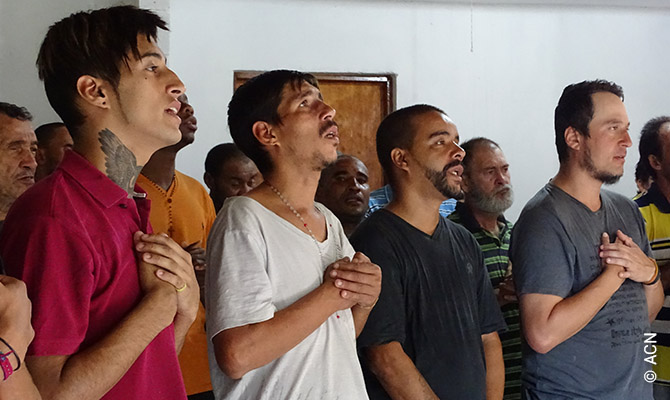 Former homeless people from Balca praying in Sao Paulo.