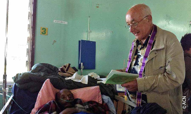 A priest visiting sick people in a hospital.